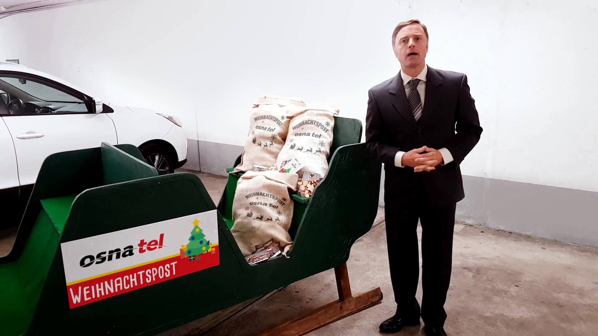 osnatel-weihnachtsgruss-2017-schlittenschild-jutesack